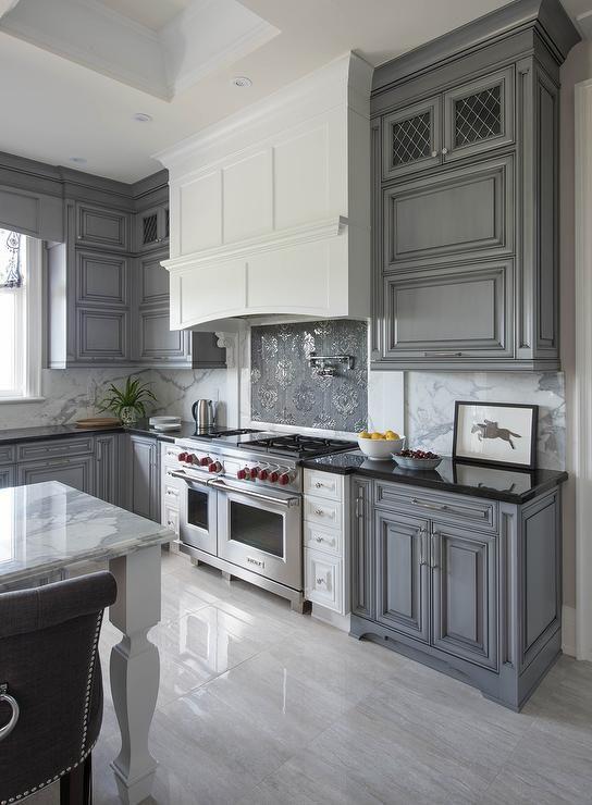 grey kitchen with black granite worktops